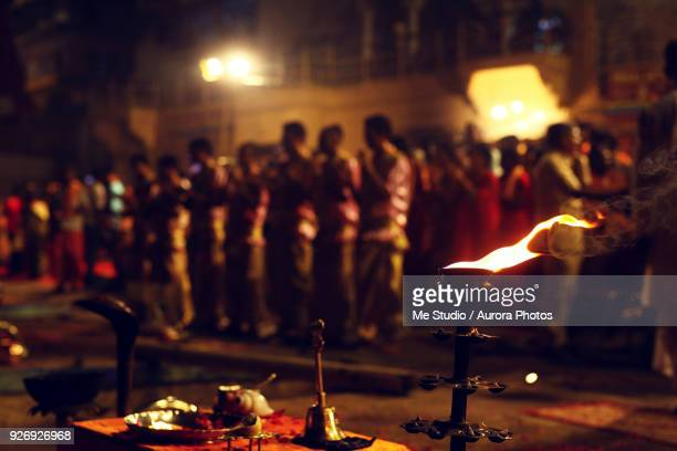 ganga aarti ceremony held on edge of ganges river, varanasi, uttar pradesh, india - religious vigil stock photos and pictures
