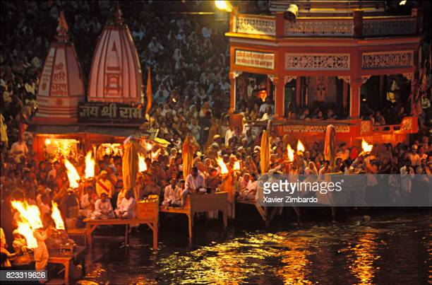 Ganga Aarti offering of the light at HarkiPauri Ghat on the banks of the river Ganga in the evening at the time of the Ceremony of Twilight during...