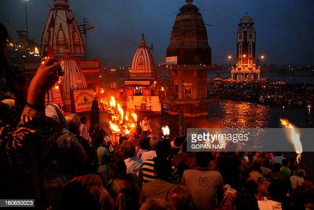 CONTENT] Ganga Aarti or worship at Haridwar Harki pauri ghat in the evening when the daily ritual of 'Maha Aarti' takes place When the sun goes down...