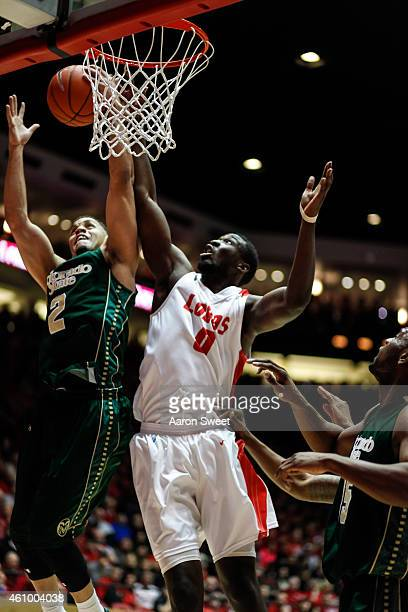 Ganga of the New Mexico Lobos fights for the rebound against Daniel Bejarano of the Colorado State Rams during their game at The WisePies Arena on...