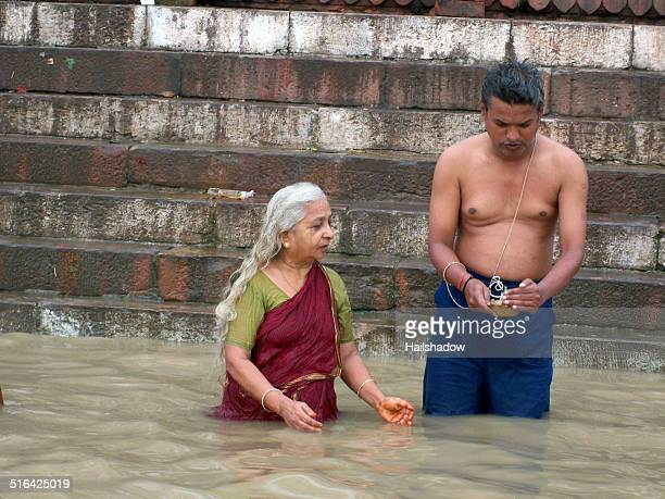ganga river prayers - nude hindu women stock photos and pictures