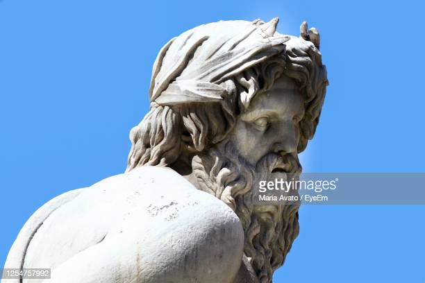 ganges, marble detail of the face. fountain of the four rivers in piazza navona in rome. - philosophy stock pictures, royalty-free photos & images