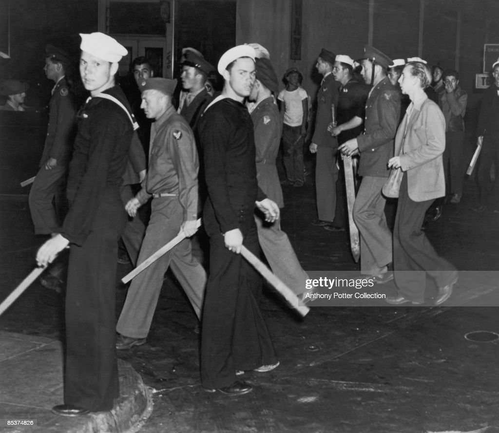 Gangs of American sailors and marines armed with sticks during the Zoot Suit Riots, Los Angeles, California, June 1943. The riots broke out as tensions rose between between servicemen stationed in the city and Latino youths, amongst whom zoot suits were the latest fashion.
