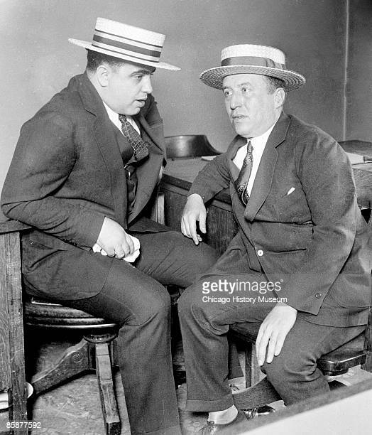 Gangster Al Capone and an unidentified man likely bail bondsman Isaac Roderick sit together in discussion in Chicago 1926 From the Chicago Daily News...