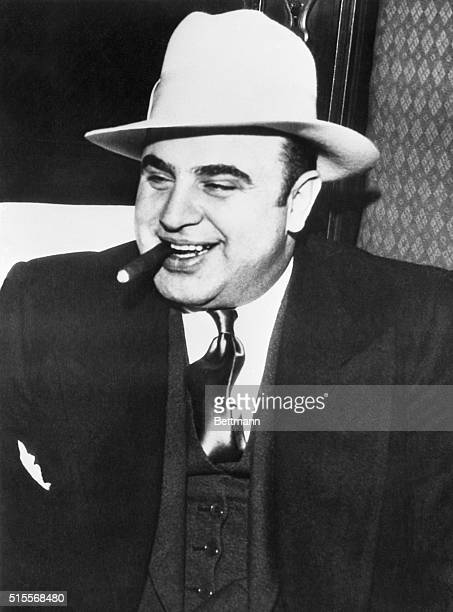 Gangster Al Capone in the heavily guarded train which bore him to federal prison.