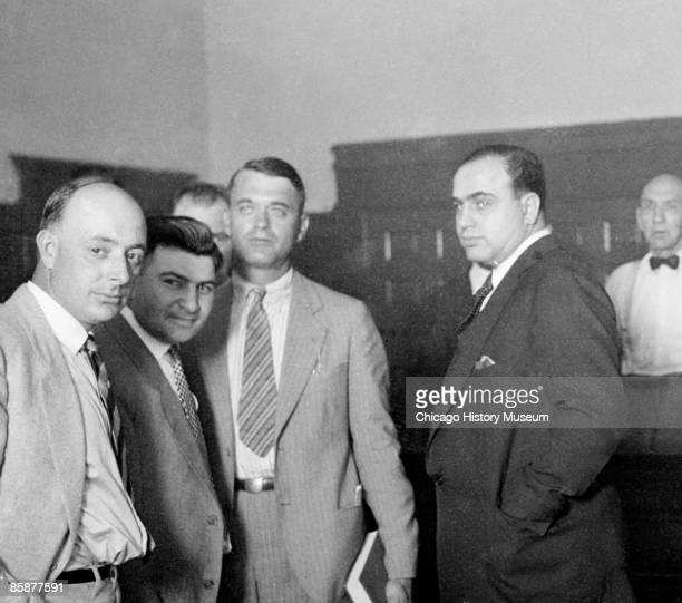 Gangster Al Capone standing with a group of men in court Chicago 1926 He would return in 1929 and 1931 but was never prosecuted for a Prohibition...