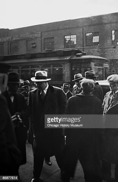 Gangster Al Capone walks through a group of men on a sidewalk Chicago ca1920s