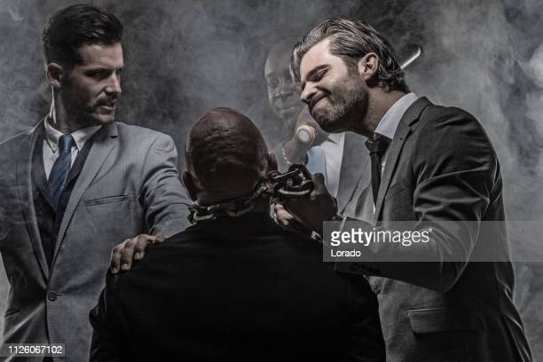 gangster mafia men - torture stock pictures, royalty-free photos & images