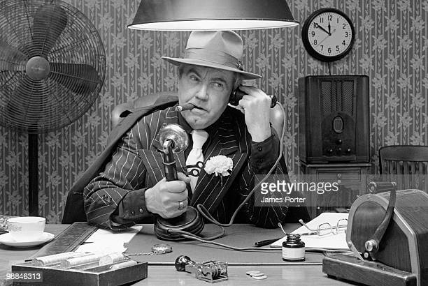 gangster on telephone - candlestick phone stock pictures, royalty-free photos & images