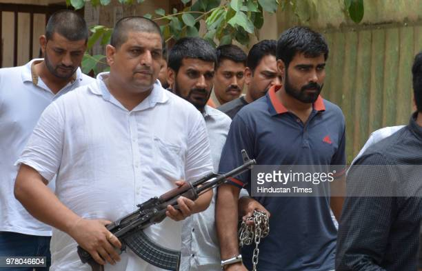 Gangster Sampat Nehra outside the court after being sent to judicial custody at Panchkula Court on June 18 2018 in Panchkula India Two weeks after...