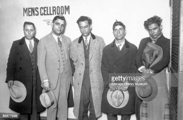 Gangsters lined up in a Chicago jail from left to right Mike Bizarro Joe Aiello Joe Bubinello Nick Manzello and Joe Russio ca1920s