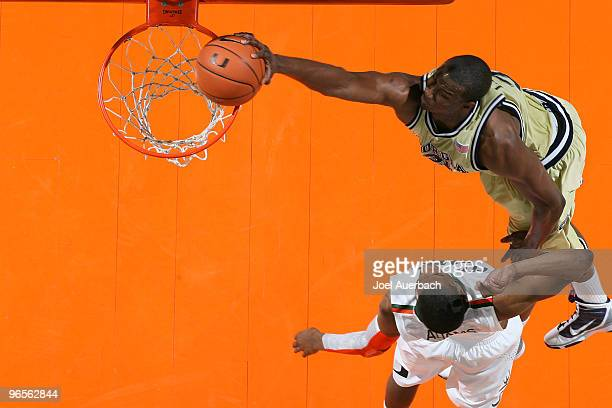 Gani Lawal of the Georgia Tech Yellow Jackets goes to the basket over Garrius Adams of the Miami Hurricanes on February 10 2010 at the BankUnited...