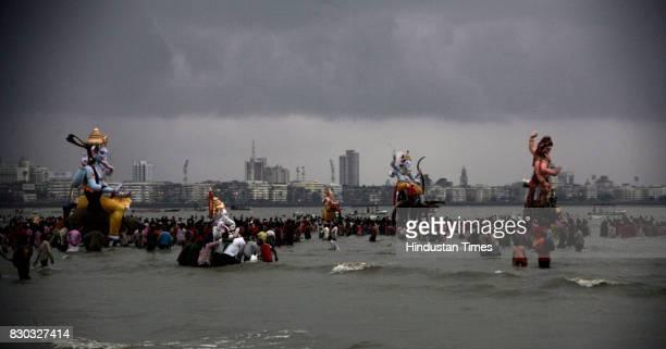 Ganpati Visarjan Devotees carry a statue of Ganesh Idol for immersion in the sea in Mumbai