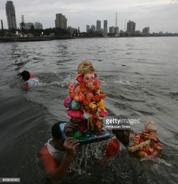 Ganpati Visarjan Volunteers escorts the city's favorite God into the sea at Dadar Chowpatty on Monday