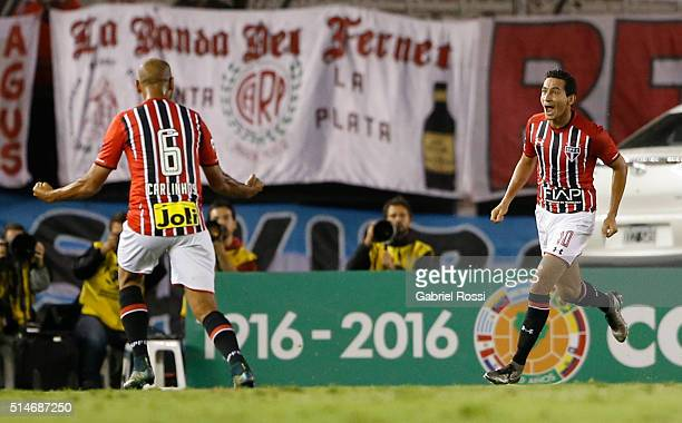 Ganso of Sao Paulo celebrates with Carlinhos after scoring the first goal of his team during a match between River Plate and Sao Paulo as part of...