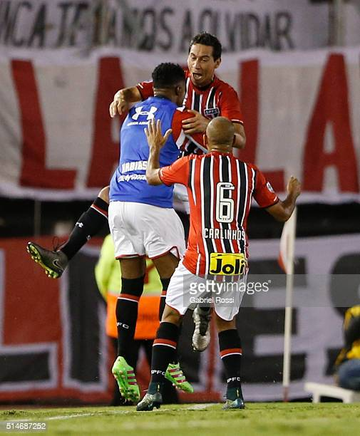 Ganso of Sao Paulo celebrates with teammates after scoring the first goal of his team during a match between River Plate and Sao Paulo as part of...