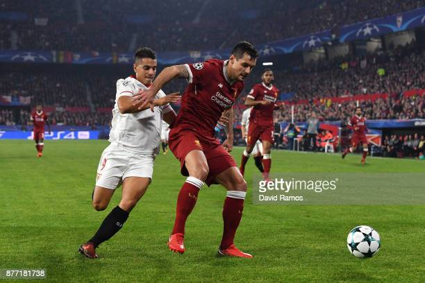 Ganso of Sevilla and Dejan Lovren of Liverpool battle for possession during the UEFA Champions League group E match between Sevilla FC and Liverpool...