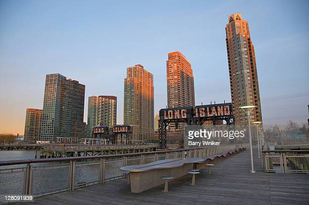 Gantries now in front of newly-completed condominium and rental towers, Gantry Pier at Gantry Plaza State Park, opened 1998, Hunter's Point, Long Island City, Queens, New York, U.S.A.