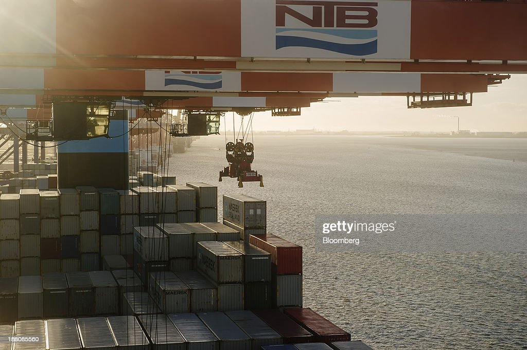 A gantry crane collects a shipping container from the deck of the Maersk Mc-Kinney Moeller Triple-E Class container ship, operated by A.P. Moeller-Maersk A/S, during unloading at the Port of Bremerhaven in Bremerhaven, Germany, on Monday, Nov. 11, 2013. A.P. Moeller-Maersk A/S's container-shipping line, the world's largest, reported an 11 percent increase in third-quarter profit after cost cuts countered a decline in freight rates. Photographer: Kristian Helgesen/Bloomberg via Getty Images