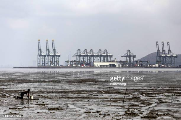 Gantry cranes operated by PSA International Pte stand at the Jawaharlal Nehru Port, operated by Jawaharlal Nehru Port Trust , in Navi Mumbai,...