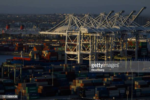 Gantry cranes stand at the Port of Los Angeles in this aerial photograph taken above Los Angeles California US on Friday May 1 2020...