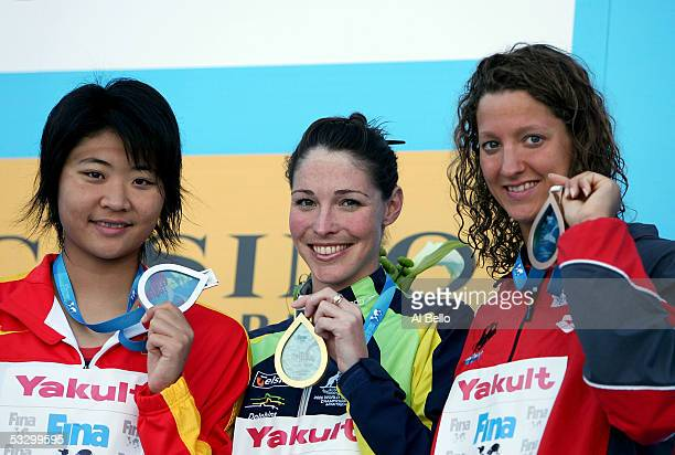 Gao Chang of China wins the silver medal Giaan Rooney of Australia wins the gold medal and Antje Buschschulte of Germany wins the bronze medal in the...