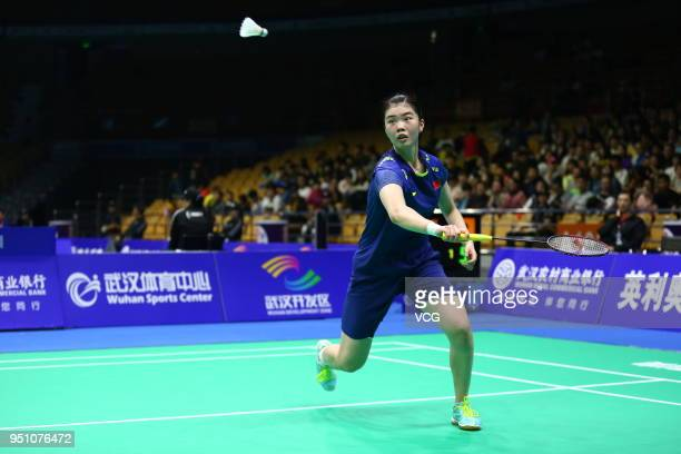 Gao Fangjie of China competes against Nozomi Okuhara of Japan during women's singles first round match on day two of 2018 Badminton Asia...