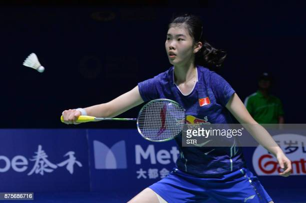 Gao Fangjie of China hits a return against Carolina Marin of Spain during their women's singles semifinal match at the China Open 2017 Badminton...