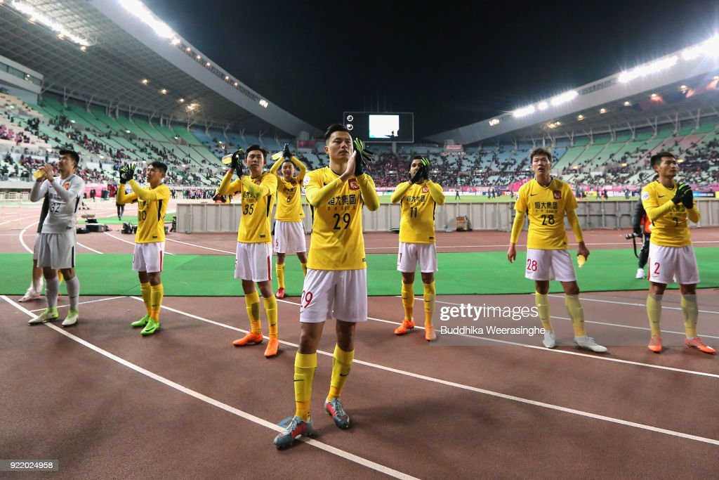 Gao Lin and Guangzhou Evergrande players applaud away supporters after the scoreless draw in the AFC Champions League Group G match between Cerezo Osaka and Gunazhou Evergrande at the Yanmar Stadium Nagai on February 21, 2018 in Osaka, Japan.
