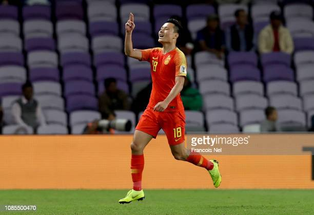 Gao Lin of China celebrates scoring his sides second goal from a penalty during the AFC Asian Cup round of 16 match between Thailand and China at...