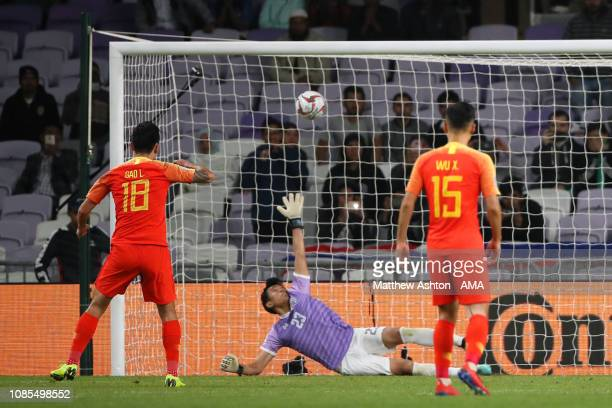 Gao Lin of China scores a goal from the penalty spot to make it 1-2 during the AFC Asian Cup round of 16 match between Thailand and China at Hazza...