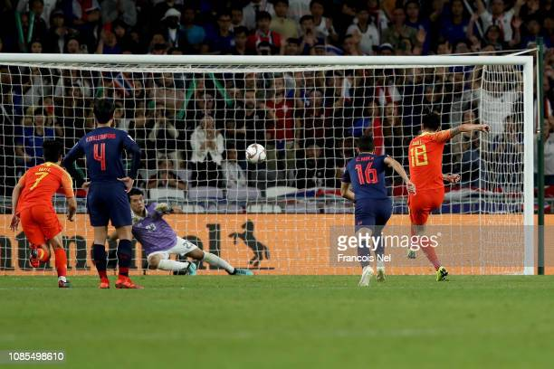 Gao Lin of China scores his sides second goal from a penalty during the AFC Asian Cup round of 16 match between Thailand and China at Hazza Bin Zayed...