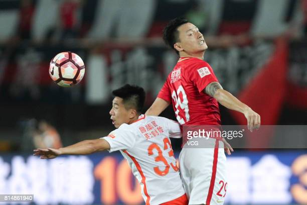 Gao Lin of Guangzhou Evergrande and Jin Jingdao of Shandong Luneng compete for the ball during the 17th round match of 2017 Chinese Football...