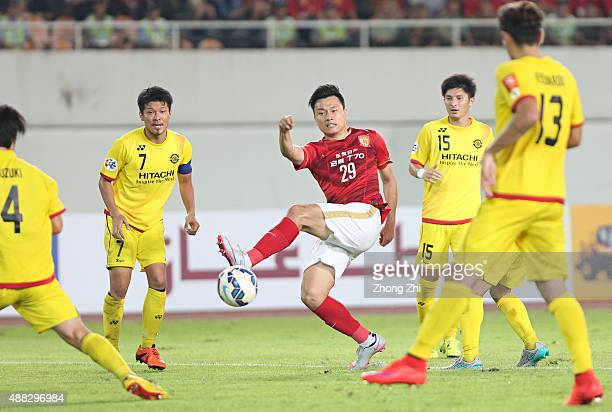 Gao Lin of Guangzhou Evergrande attempts a goal against Otani Hidekazu of Kashiwa Reysol during the Asian Champions League Quarter Final match...