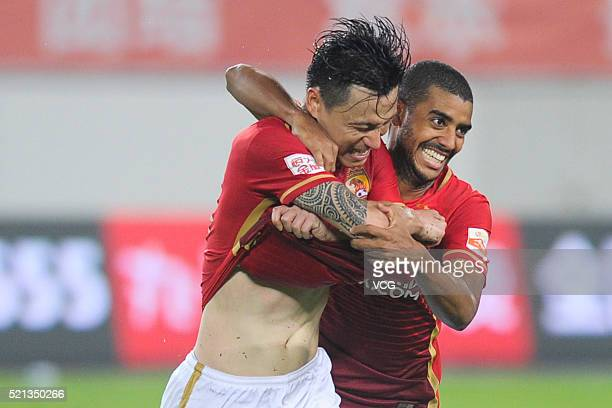 Gao Lin of Guangzhou Evergrande celebrates with Alan Carvalho after scoring a goal during the Chinese Football Association Super League match between...