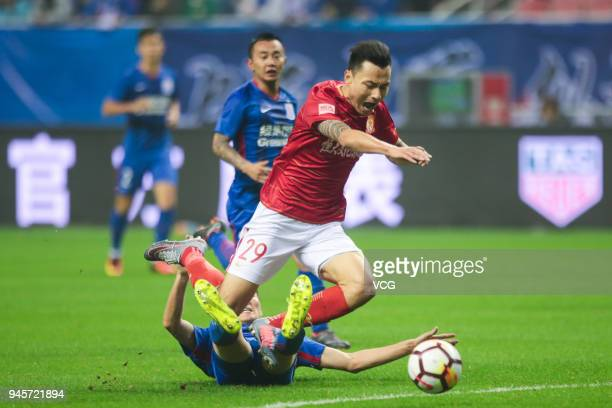 Gao Lin of Guangzhou Evergrande falls down during the 2018 Chinese Super League 6th round match between Shanghai Shenhua and Guangzhou Evergrande at...