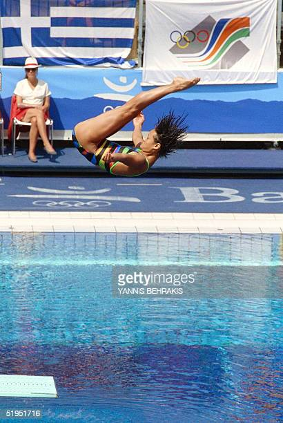 Gao Min of China performs a dive 03 August 1992 during the 3meter springboard finals at the 1992 Olympic Games in Barcelona Min nicknamed the 'little...