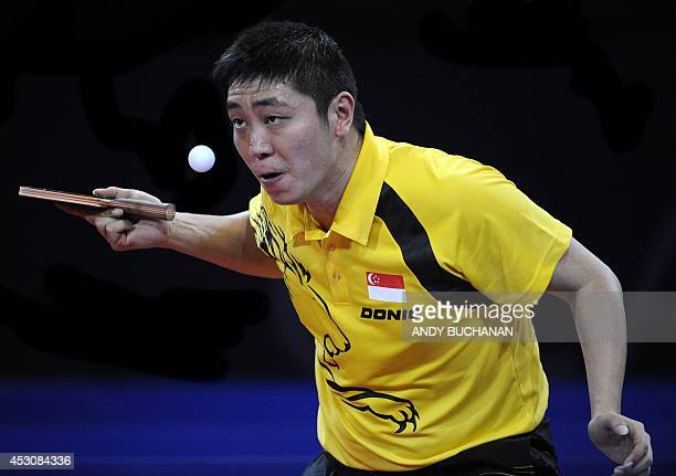 Gao Ning of Singapore in action against Zhan Jian of Singapore in the gold medal match in the men's singles Table Tennis competition at Scotstoun...