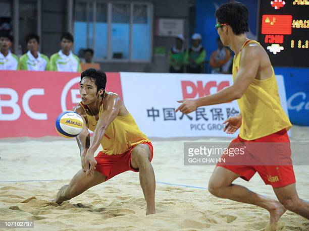 Gao Peng of China retrieves a shot during the beach volleyball men's final match at the 16th Asian Games in Guangzhou on November 24 2010 Xu Linyin...