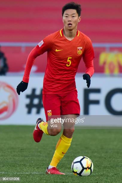 Gao Zhunyi of China drives the ball during the AFC U23 Championship Group A match between Uzbekistan and China at Changzhou Olympic Sports Center on...