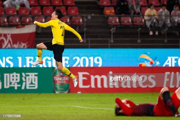 Gao Zhunyi of Guangzhou Evergrande celebrates victory during the AFC Champions League quarter final second leg match between Kashima Antlers and...