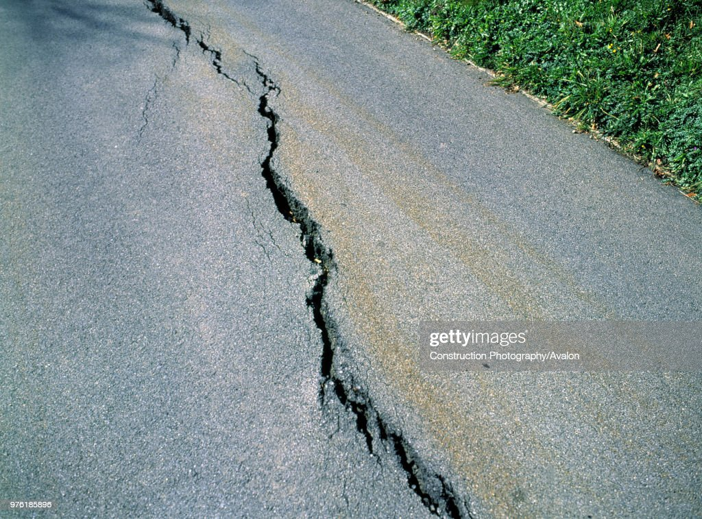 Gap cutting through paved road following an earthquake : News Photo