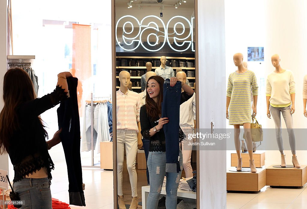 Gap employee Shinju Nozawa-Auclair folds clothes at a Gap store on February 20, 2014 in San Francisco, California. Gap Inc. announced that they will raise their minimum wage for U.S. employees to nine dollars in June of 2014 and to $10 by June of 2015.