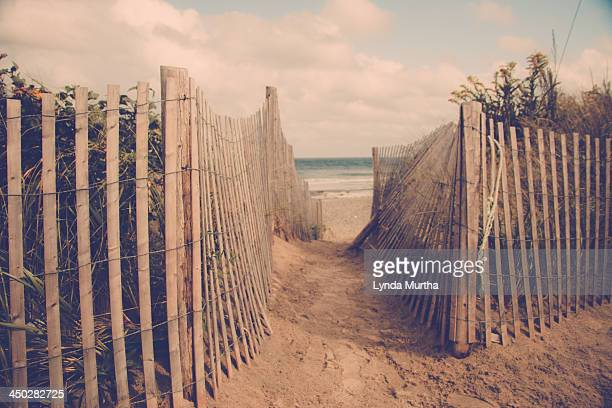 Gap in beach fence leading to ocean