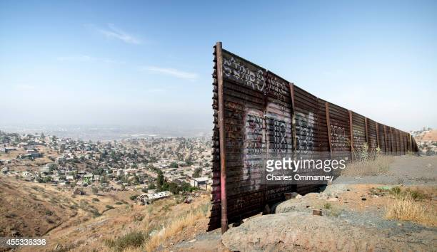 A gap in the fence near the USMexico border overlooking Tijuana Mexico on May 27 2014 near San Diego California