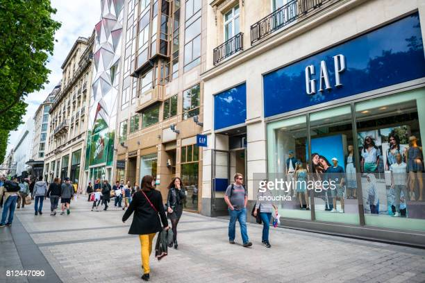 gap store on avenue des champs-elysees, paris, france - brand name stock pictures, royalty-free photos & images