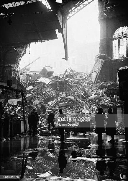 A gapping hole in the ceiling of Liverpool Street Station following an air raid ca 1940