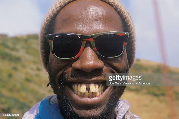 A gaptoothed AfricanAmerican man smiling San Francisco CA