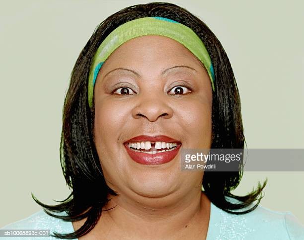 gap-toothed woman smiling, portrait, close-up - images of fat black women stock photos and pictures