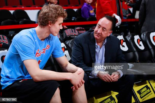 Gar Forman and Lauri Markkanen of the Chicago Bulls talk before the game against the Los Angeles Lakers on January 26 2018 at the United Center in...